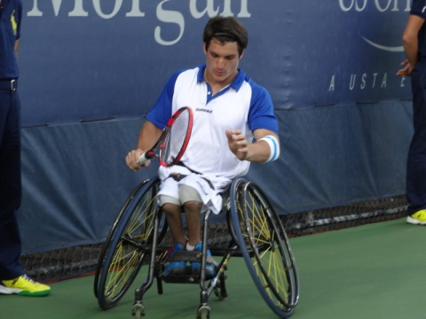 Gustavo just won a point against S. Kunieda at the 2014 Men's Singles Wheelchair Tennis Finals.