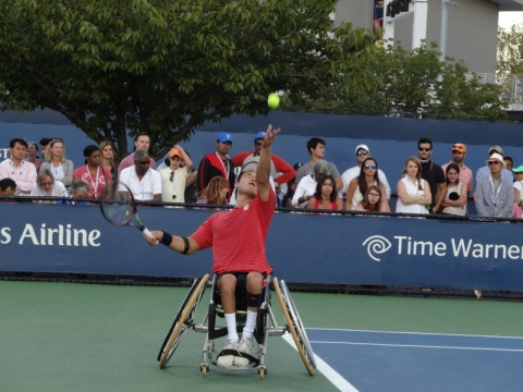 S. Kuneida from Japan with a dynamite serve. 2014 Men's Singles Wheelchair Tennis Finals