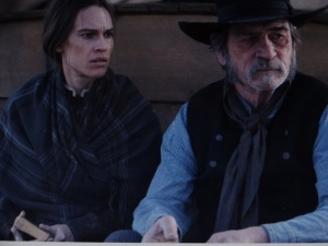 Hillary Swank and Tommy Lee Jones in 'The Homesman,' directed by Tommy Lee Jones. Photo taken from the film trailer.