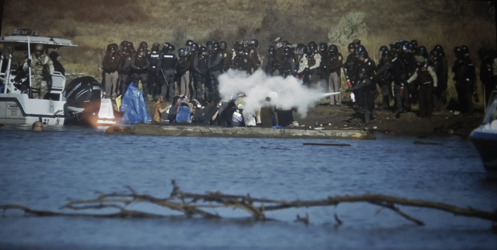 Tear gas, rubber bullets, fire extinguishers were used against unarmed water protectors. 'End of The Line: The Women of Standing Rock,' (courtesy of the film)