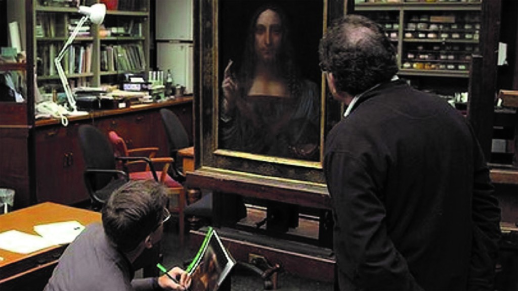 Robert Simon inspection of the Salvator Mundi at the National Gallery (2011). Copyright Robert Simon - Courtesy of Sony Pictures Classics. Updated by Charlotte Sather for Tribeca Film Festival 2021